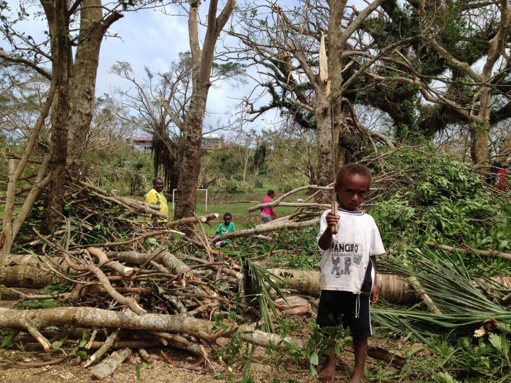 This handout photo taken on March 14, 2015 and released to AFP on March 15 by Australian Red Cross shows children among debris while residents deal with the damage to their homes in Seaside, near the Vanuatu capital of Port Vila. Vanuatu's president made an emotional appeal for international assistance after his island nation was hit by a calamity of a cyclone, wreaking devastation in what is feared to be one of the region's worst weather disasters. Vanuatu declared a state of emergency on March 15, saying six people were confirmed dead as a result of the monster storm with the toll expected to rise. (Chris McCowage/Australian Red Cross/AFP/Getty Images)