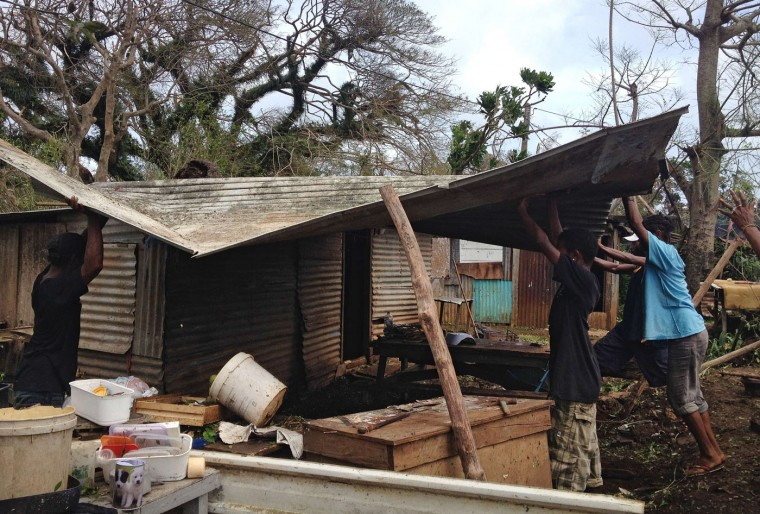 This handout photo taken on March 14, 2015 and released to AFP on March 15 by Australian Red Cross shows people clearing up debris and dealing with the damage to their homes in Seaside, near the Vanuatu capital of Port Vila. Vanuatu's president made an emotional appeal for international assistance after his island nation was hit by a calamity of a cyclone, wreaking devastation in what is feared to be one of the region's worst weather disasters. Vanuatu declared a state of emergency on March 15, saying six people were confirmed dead as a result of the monster storm with the toll expected to rise. (Chris McCowage/Australian Red Cross/AFP/Getty Images)