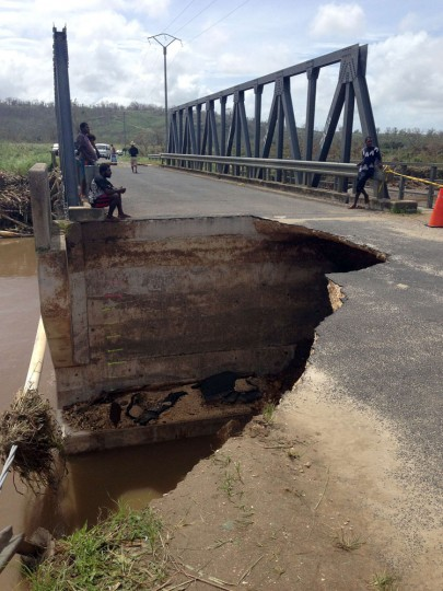 """This handout photo taken and received on March 15, 2015 by UNICEF Pacific shows damage to a bridge, caused by Cyclone Pam, near the Vanuatu capital of Port Vila. Cyclone-devastated Vanuatu declared a state of emergency on March 15 as relief agencies scrambled to get help to the remote Pacific nation amid reports entire villages were """"blown away"""" when the monster storm swept through. (UNICEF Pacific/AFP/Getty Images)"""