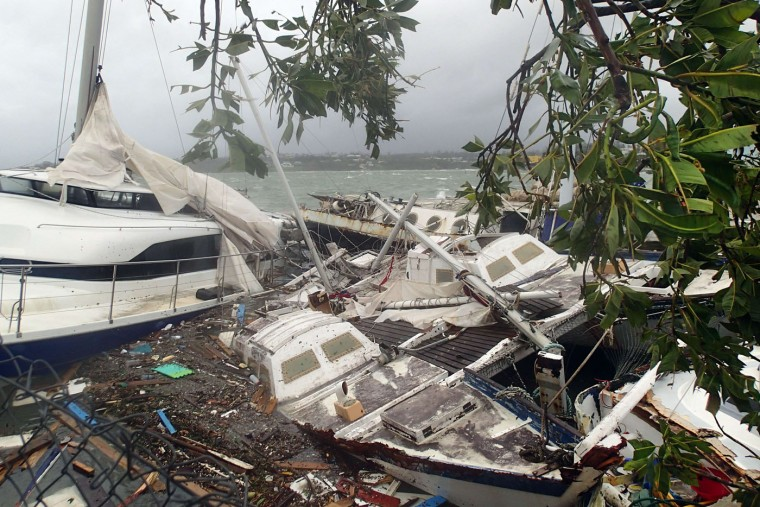 """This handout photo taken on March 14, 2015 and received on March 15 by CARE Australia shows storm damage to boats caused by Cyclone Pam, in the Vanuatu capital of Port Vila. Cyclone-devastated Vanuatu declared a state of emergency on March 15 as relief agencies scrambled to get help to the remote Pacific nation amid reports entire villages were """"blown away"""" when the monster storm swept through. (Inga Mepham/Care/AFP/Getty Images)"""