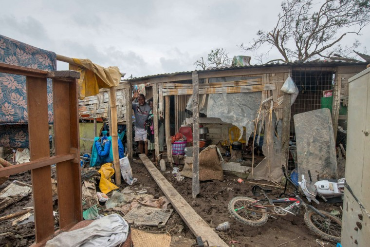 """This handout photo taken and received on March 15, 2015 by UNICEF Pacific shows a resident's home badly damaged by Cyclone Pam, outside the Vanuatu capital of Port Vila. Cyclone-devastated Vanuatu declared a state of emergency on March 15 as relief agencies scrambled to get help to the remote Pacific nation amid reports entire villages were """"blown away"""" when the monster storm swept through. (UNICEF Pacific/AFP/Getty Images)"""