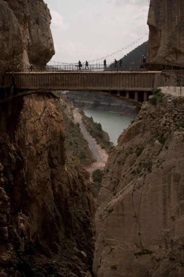 "Journalists and visitors cross a bridge during a visit to the foot-path ""El Caminito del Rey"" (King's little path) a narrow walkway hanging and carved on the steep walls of a defile in Ardales near Malaga on March 15, 2015. (Jorge Guerrero/AFP/Getty Images)"