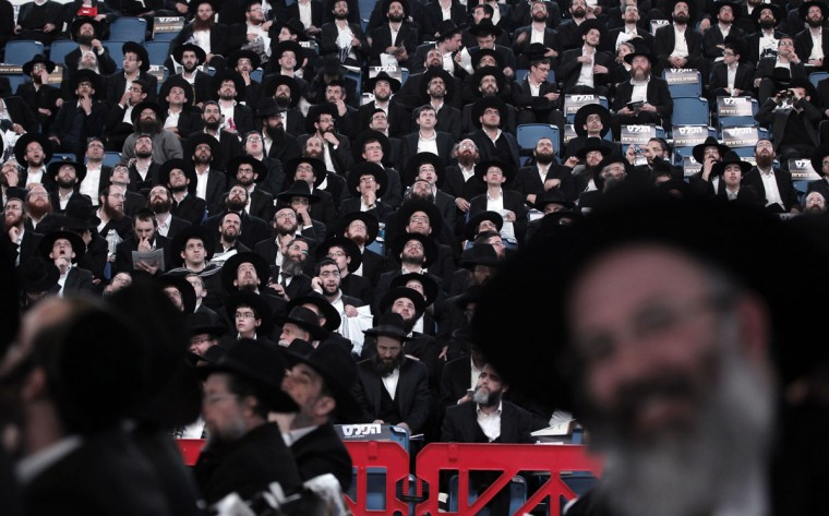 Thousands of ultra-Orthodox Ashkenazi Jews gather in a sports arena in Jerusalem on March 15, 2015, in a show of force less than two days before general elections. Israel goes to the polls on March 17, 2015 for the second general election in as many years with pundits unanimous that it is turning out to be a referendum on Prime Minister Benjamin Netanyahu's six years as premier. (AFP Photo/Ahmad Gharabli)