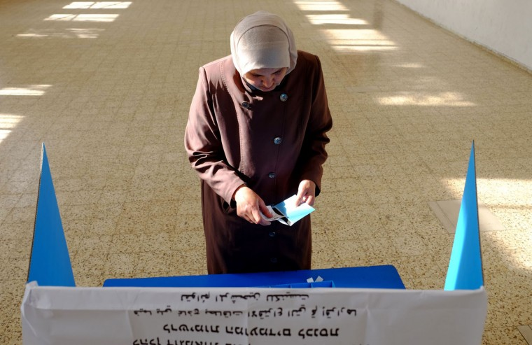 An Arab Israeli woman prepares to cast her ballot at a polling station in the northern Israeli town of Umm al-Fahm on March 17, 2015. Voting polls opened for unpredictable elections to determine whether Israelis still want incumbent Prime Minister Benjamin Netanyahu as leader, or will seek change after six years. (Ahmad Gharabli/AFP/Getty Images)
