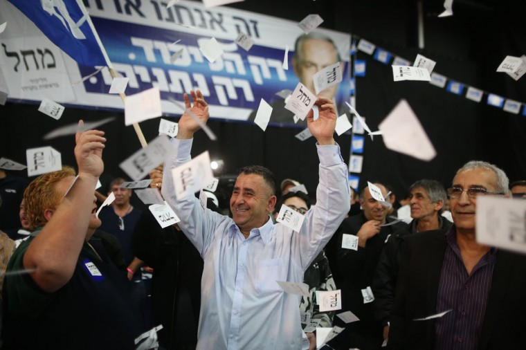 Israeli Likud Party supporters react to the exit polls while they wait for the announcement of the first official results of Israel's parliamentary elections on March 17, 2015 at the party's headquarters in the city of Tel Aviv. Israeli Prime Minister Benjamin Netanyahu's rightwing Likud party is neck-and-neck with the centre-left Zionist Union in the general election, exit polls said. (Menahem Kahana/AFP/Getty Images)