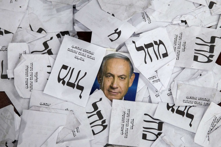 Copies of ballots papers and campaign posters for Israel's Prime Minister Benjamin Netanyahu's Likud Party lie on the ground in the aftermath of the country's parliamentary elections, early on March 18, 2015 in Tel Aviv. Netanyahu beat the odds to win a resounding election victory that will likely deepen tensions with the Palestinians and the West. (Jack Guez/AFP/Getty Images)