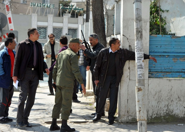 Armed Tunisian policemen in plainclothes secure the area after gunmen attacked Tunis' famed Bardo Museum on March 18, 2015. At least seven foreigners and a Tunisian were killed in an attack by two men armed with assault rifles on the museum, the interior ministry said. (AFP Photo/Fethi Belaid)
