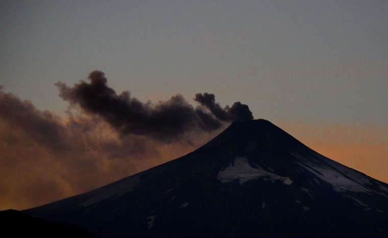 View of the Villarrica volcano from Pucon, some 800 km south of Santiago, showing visible signs of activity on March 21, 2015. Earlier this month, in its first major eruption in 15 years, the Villarrica forced the evacuation of thousands of people amid a shower of fire and ash. (Martin Bernetti/AFP/Getty Images)
