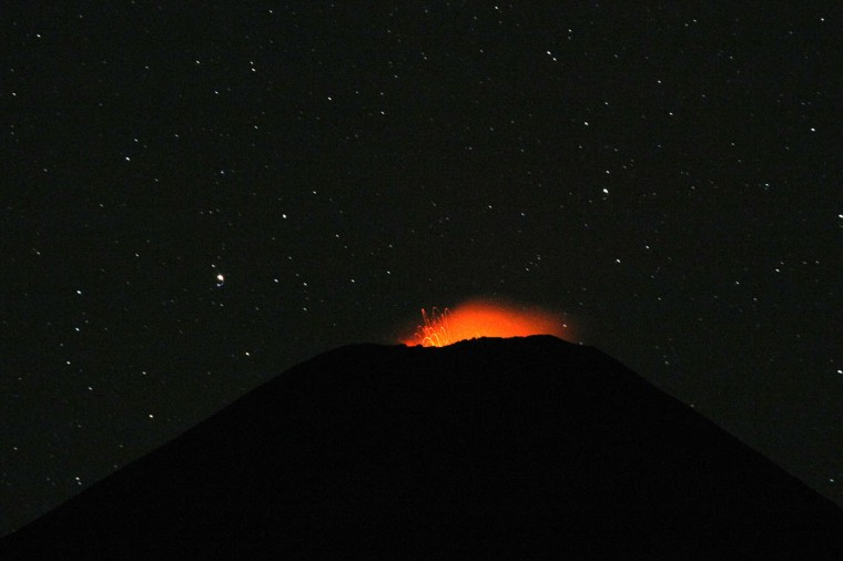 View of the Villarrica volcano, some 800 km south of Santiago, showing visible signs of activity on March 25, 2015. Earlier this month, in its first major eruption in 15 years, the Villarrica forced the evacuation of thousands of people amid a shower of fire and ash. (Sebastian Escobar/AFP/Getty Images)
