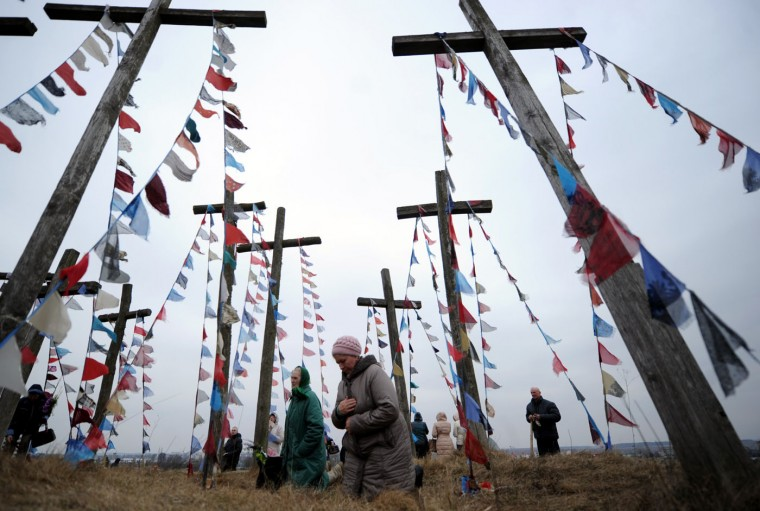 Belarus' Catholics pray on a hill with wooden crosses while celebrating Palm Sunday in the town of Oshmiany, some 130 kilometers northwest of Minsk, on March 29, 2015. (Sergei Gapon/AFP/Getty Images)