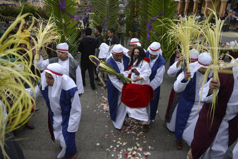 Members of the Sagrado Corazon de Jesus brotherhood carry an image of Jesus Christ during the traditional Palm Sunday procession on March 29, 2015 in San Pedro Sacatepequez, 30 km west of Guatemala City. (Johan Ordonez/AFP/Getty Images)