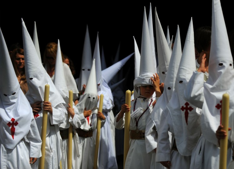 Members of the Borriquita brotherhood hold palm leaves during celebrations marking the Christian feast of Palm Sunday in Sevilla on March 29, 2014. Palm Sunday held annually on the Sunday before Easter and commemorates the entry into Jerusalem of Jesus Christ. (Cristina Quicler/AFP/Getty Images)