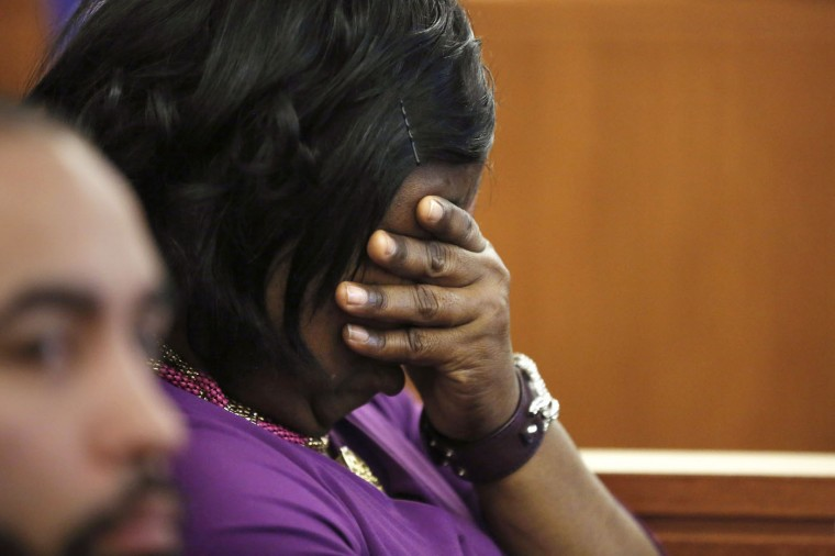 Ursula Ward, mother of murder victim Odin Lloyd, center, puts her hand on her face as an image of her son's body is displayed on a monitor during the murder trial of former New England Patriots football player Aaron Hernandez, Thursday, March 19, 2015, in Fall River, Mass. Hernandez is charged with killing Lloyd. (AP Photo/Steven Senne, Pool)