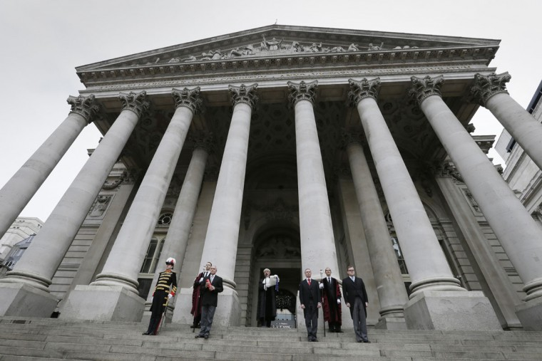 Colonel Geoffrey Godbold, the Common Cryer and Serjeant-at-Arms of the City of London, centre, announces the summoning of a new Parliament following the dissolution of Parliament, from the steps of the Royal Exchange in London, Monday, March 30, 2015. (AP Photo/Tim Ireland)
