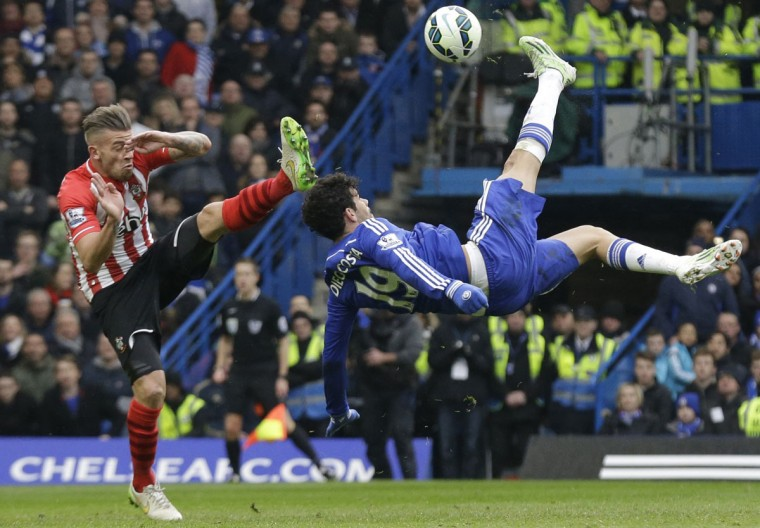 FILE - In this Sunday, March 15, 2015 file photo Chelsea's Diego Costa, right, competes for the ball with Southampton's Toby Alderweireld, during the English Premier League soccer match between Chelsea and Southampton at Stamford Bridge stadium in London. (AP Photo/Matt Dunham, File)