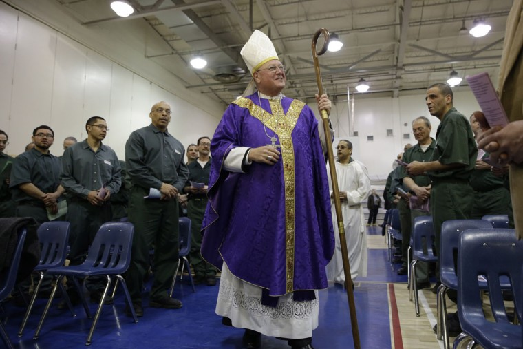 Cardinal Timothy Dolan arrives to celebrate Mass at the Otisville Correctional Facility, Monday, March 30, 2015, in Otisville, N.Y. Otisville is a medium-security male correctional facility housing approximately 566 inmates, with 154 inmates whose religion is Catholic. (AP Photo/Mary Altaffer)