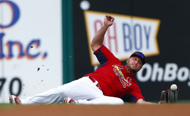 St. Louis Cardinals left fielder Matt Holliday (7) can't hang on to a ball hit for a single by Miami Marlins' Jarrod Saltalamacchia in the second inning of an exhibition spring training baseball game Thursday, March 26, 2015, in Jupiter, Fla. (AP Photo/John Bazemore)