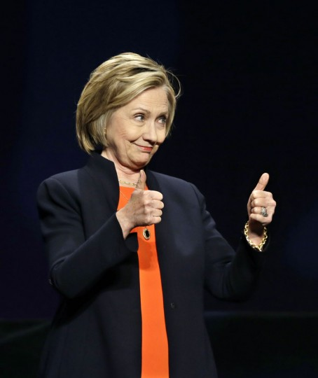 Former Secretary of State Hillary Rodham Clinton gives thumbs up as she addresses around 3,000 summer camp and out of school time professionals at the American Camp Association and Tri State CAMP conference Thursday, March 19, 2015, in Atlantic City, N.J. (AP Photo/Mel Evans)
