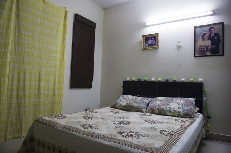 "The bedroom of Andrew Nari, 50, in his house outside Kuala Lumpur, Malaysia. Nari was the Chief Steward aboard flight 370 when it disappeared March 8, 2014, while flying from Kuala Lumpur to Beijing. Nari's wife, Melanie Antonio, 46, says ""nothing has changed"" in their shared bedroom ""besides the new shared wardrobe."" (AP Photo/Joshua Paul)"