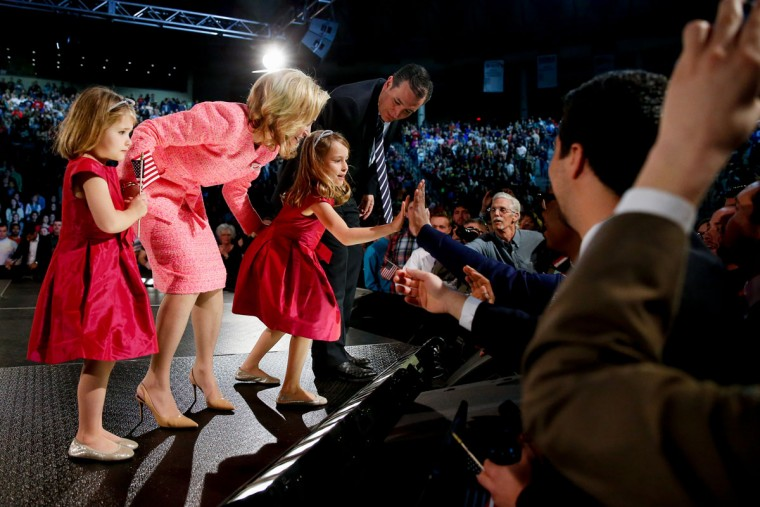 Sen. Ted Cruz, R-Texas and his wife Heidi watch as their daughter Caroline, 6, center, high-fives members of the crowd after Cruz announced his campaign for president, Monday, March 23, 2015, at Liberty University, founded by the late Rev. Jerry Falwell, in Lynchburg, Va. Cruz, who announced his candidacy on twitter in the early morning hours, is the first major candidate in the 2016 race for president. Also pictured is Catherine Cruz, 4, left. (AP Photo/Andrew Harnik)