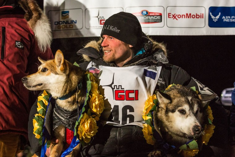 Dallas Seavey poses with his lead dogs Reef, left, and Hero in Nome, Alaska on Wednesday, March 18, 2015 during the Iditarod Trail Sled Dog Race. Seavey won his third Iditarod in the last four years, beating his father, Mitch, to the finish line after racing 1,000 miles across Alaska. (AP Photo/Alaska Dispatch News, Loren Holmes )