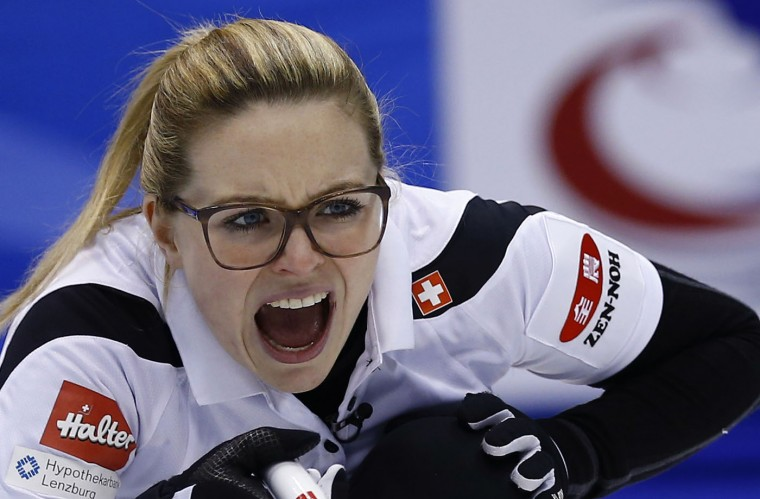Switzerland's Alina Paetz yells as the team plays Canada during the 8th end of the final match of the women's World Curling Championships in Sapporo, northern Japan, Sunday, March 22, 2015. Switzerland defeated Canada 5-3 and won the championship title. (AP Photo/Shizuo Kambayashi)