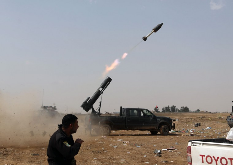 Iraqi security forces launch a rocket against Islamic State extremist positions during clashes in Tikrit, 130 kilometers (80 miles) north of Baghdad, Iraq, Monday, March 30, 2015. (AP Photo/Khalid Mohammed)