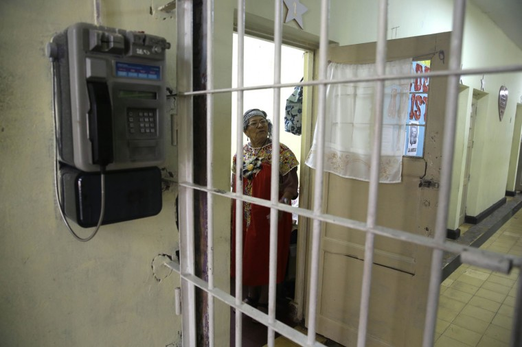 In this Jan. 30, 2015 photo, prisoner Teresa de Jesus Tello stands inside her cell at the Santa Monica women's prison in Lima, Peru. The retired Peruvian teacher and mother of seven was arrested by anti-drug police at Limaís Jorge Chavez airport at the end of 2014 when she allegedly tried to take a small suitcase filled with cocaine on a flight to Madrid, Spain. (AP Photo/Martin Mejia)