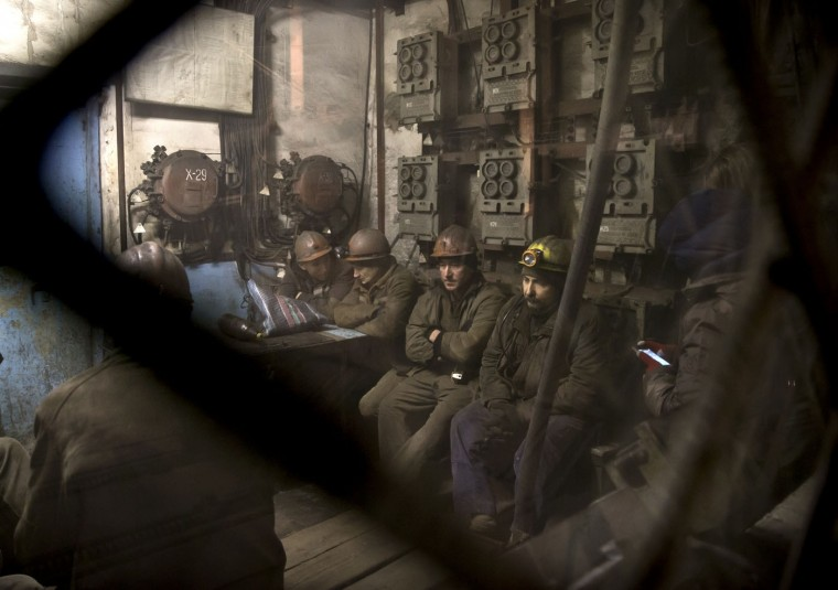Ukrainian coal miners wait in a room before going underground at the Zasyadko mine in Donetsk, Ukraine, Wednesday, March 4, 2015. (AP Photo/Vadim Ghirda)