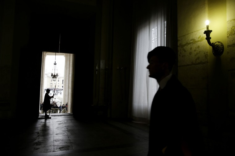 Swiss guards stand at the Bronze door prior to the start of a private audience Pope Francis granted to Nechirvan Barzani, prime minister of Iraq's Kurdistan regional government, at the Vatican, Monday, March 2, 2015. (AP Photo/Gregorio Borgia, Pool)