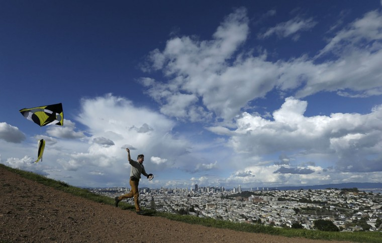 Ted Nace flies a kite atop Bernal Heights Hill in San Francisco, Saturday, Feb. 28, 2015. (AP Photo/Jeff Chiu)