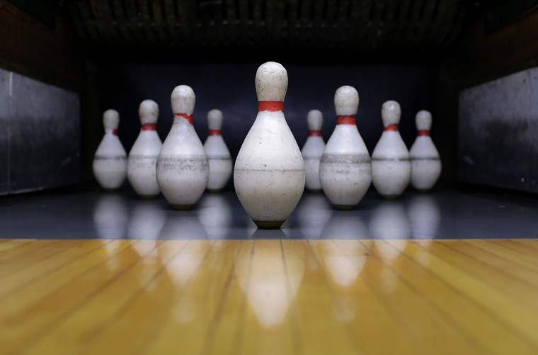 Pins sit on a bowling lane for duckpin bowling at Shenandoah Bowling Lanes, Saturday, March 28, 2015, in Mount Jackson, Va. Duckpin bowling is a variation of the more popular 10-pin bowling, with smaller pins and a ball slightly larger than a softball. (AP Photo/Patrick Semansky)