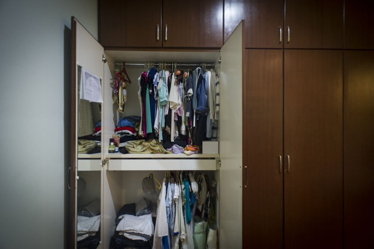 "Part of a shared wardrobe filled with Foong Wai Yuengís clothes and personal belongings in her house outside Kuala Lumpur, Malaysia. Her husband , Lee Khim Fatt, says ""Everything is the way it was since the day she left."" He says, ""I'm not going to change or move anything, just let it be the way it is. I believe she will come home, and things will be just how it was before"". (AP Photo/Joshua Paul)"