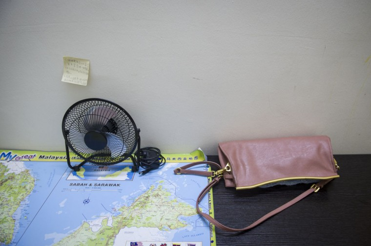 The handbag and table fan of Foong Wai Yueng, 40, in her house outside Kuala Lumpur, Malaysia. Yueng, 40, was a stewardess who was aboard Malaysian Airlines flight 370 when it disappeared last March. (AP Photo/Joshua Paul)