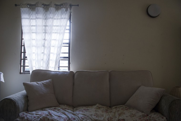 Patrick Gomes's favorite spot on his family's couch in his house outside Kuala Lumpur, Malaysia. Gomes was the in-flight supervisor aboard flight 370, which disappeared March 8, 2014, while flying from Kuala Lumpur to Beijing. (AP Photo/Joshua Paul)