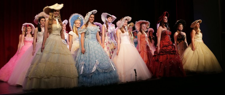 Girls show off their dresses and hats during the parade of contestants at the Azalea Trail Pageant, Sunday, March 1, 2015, in Panama City, Fla. (AP Photos/News Herald, Heather Leiphart)
