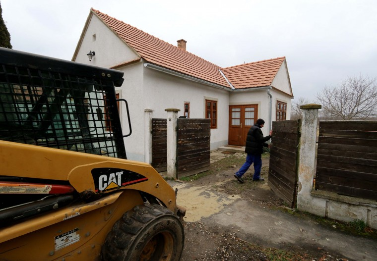 A house is pictured in the village of Megyer, Hungary, Friday, March 13, 2015. For 210,000 forints (US Dollar 730) a day, visitors get access to seven guest houses that sleep 39 people, a bus stop, horses, chickens and four hectares (10 acres) of farm land. (AP Photo/Ronald Zak)