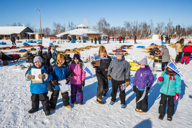 Fourth-, fifth- and sixth-graders pose for a class photo at the Huslia, Alaska, checkpoint of the Iditarod Trail Sled Dog Race, Friday, March 13, 2015. Huslia is a new checkpoint in the race. (AP Photo/Alaska Dispatch News, Loren Holmes)