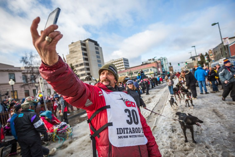 Musher Lance Mackey takes a selfie before the ceremonial start of the Iditarod sled dog race in Anchorage, Alaska, on Saturday, March 7, 2015. Mackey, a cancer survivor, is a 4-time champion. (AP Photo/Alaska Dispatch News, Loren Holmes)