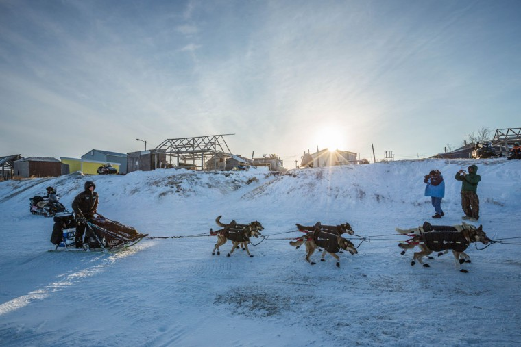 Dallas Seavey drives his team into Unalakleet in the Iditarod on Sunday, March 15, 2015. Aaron Burmeister, 39, was the first musher to reach Unalakleet, the first checkpoint on the Bering Sea coast. (AP Photo/Alaska Dispatch News, Loren Holmes)