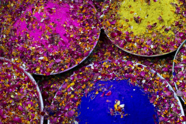 Trays filled with colored powder and flower petals lie on a floor to be used by widows to celebrate Holi, the Hindu festival of colors, at the Meera Sahabhagini Widow Ashram in Vrindavan, India, Tuesday, March 3, 2015. After their husband's deaths many of the women in the ashrams have been banished by their families, for supposedly bringing bad luck, while some move voluntarily to and around the town where devotees believe Lord Krishna was born. (AP Photo/Bernat Armangue)