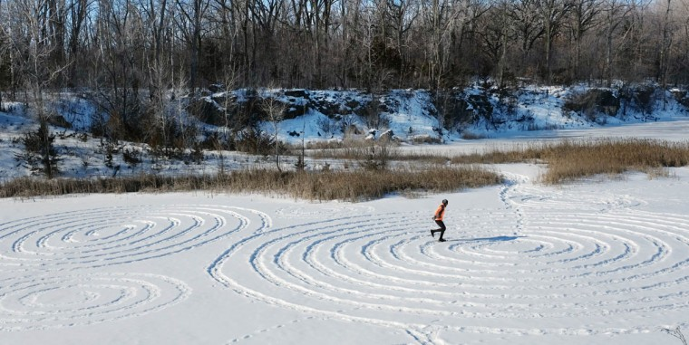 In this photo taken, Thursday, Feb. 12, 2015, Curt Krieger makes patterns in the snow while snowshoeing on a quarry lake in Mason City, Iowa. He has been making the patterns as part of a workout routine as he prepares to compete in the U.S. national snowshoe championships later this month. (AP Photo/The Globe Gazette, Arian Schuessler)