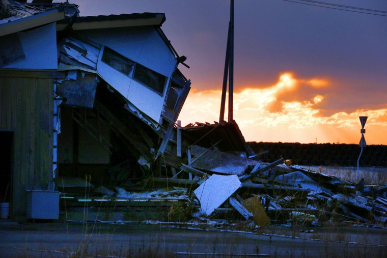 A house damaged by the March 11, 2011 earthquake and tsunami, remains in Tomioka, Fukushima prefecture, northern Japan Wednesday, March 11, 2015. Japan marked the fourth anniversary on Wednesday of the devastating disasters that left nearly 19,000 people dead or missing. (AP Photo/Kyodo News)