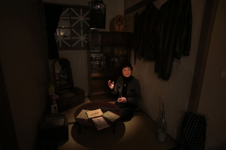Haruyo Nihei speaks at a room depicting the situation at that time of WWII under the blackout order at the Center of the Tokyo Raids and War Damage. Nihei was only 8-years-old when the biggest attack of the war, the firebombing of central Tokyo, killed over 100,000 people and left hundreds of thousands more homeless. She fled with her family and watched as many others were burned alive. As the flames swept over her, she was sheltered by her father and many others who piled on top of them who suffocated or burned to death.(AP Photo/Eugene Hoshiko)