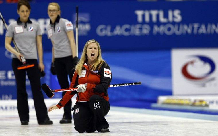 Canada's skip Jennifer Jones, front, yells as the team plays Russia during the fourth end of their semifinal match at the women's World Curling Championships in Sapporo, northern Japan, Saturday, March 21, 2015. (AP Photo/Shizuo Kambayashi)