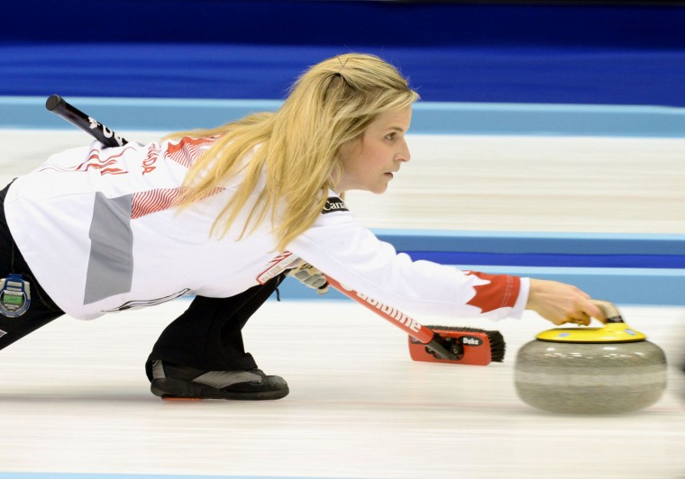 Canada's skip Jennifer Jones releases the rock as the team plays Scotland during the fifth end in the women's World Curling Championships in Sapporo, northern Japan, Sunday, March 15, 2015. (AP Photo/Kyodo News, Ryosuke Uematsu)