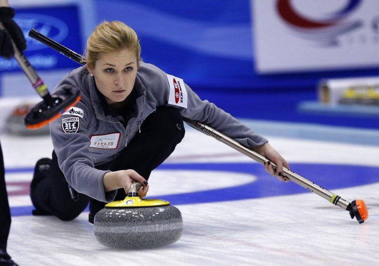 Russia's third Margarita Fomina delivers a stone in the first end during their match against Scotland for bronze medal in the World Women's Curling Championship in Sapporo, northern Japan, Sunday, March 22, 2015. (AP Photo/Shizuo Kambayashi)