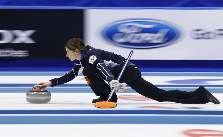 Scotland's Eve Muirhead delivers the rock as her team plays Russia in the sixth end during their match for bronze medal at the World Women's Curling Championship in Sapporo, northern Japan, Sunday, March 22, 2015. (AP Photo/Shizuo Kambayashi)