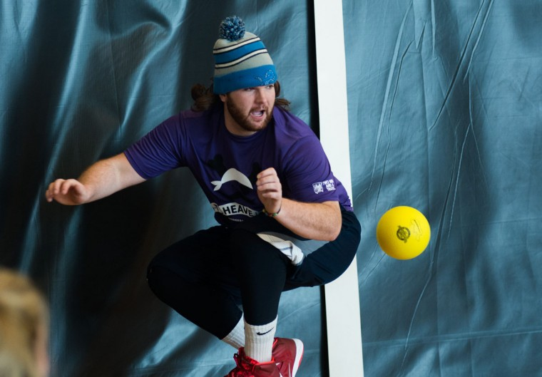 In a Saturday, Feb. 7, 2015 photo, Joe Brown jumps out of the way of a ball thrown at him by opponents during the Heave-Ho Dodgeball Battle, at the Dow Bay Area Family Y in Bay City. (AP Photo/The Bay City Times, Yfat Yossifor)