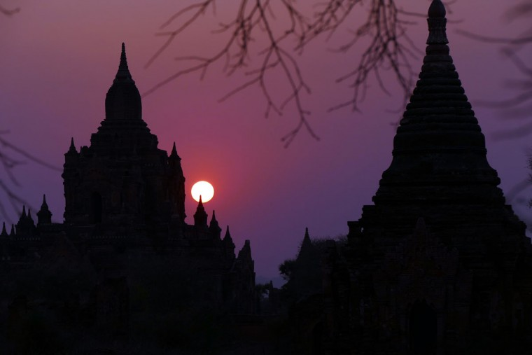 The sun sets behind old temples in Bagan, Myanmar, Tuesday Feb. 24, 2015. (AP Photo/Khin Maung Win)